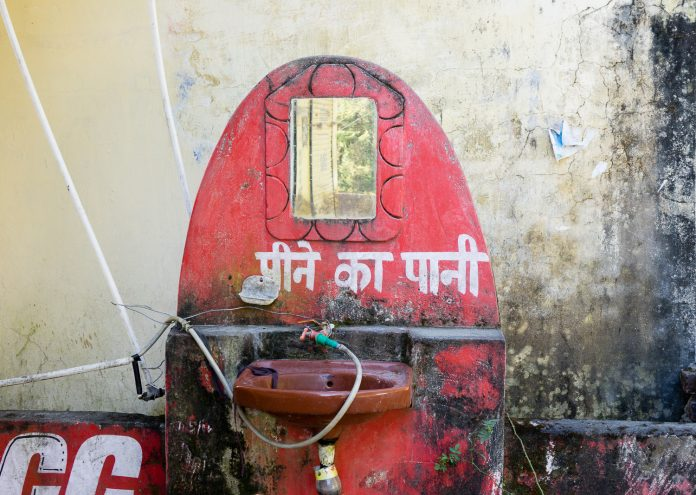 Drinking water from a contaminated tap in India