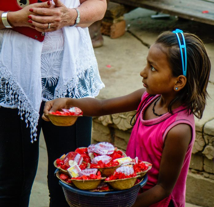 A 9 year old girl selling flowers to make money for her family.