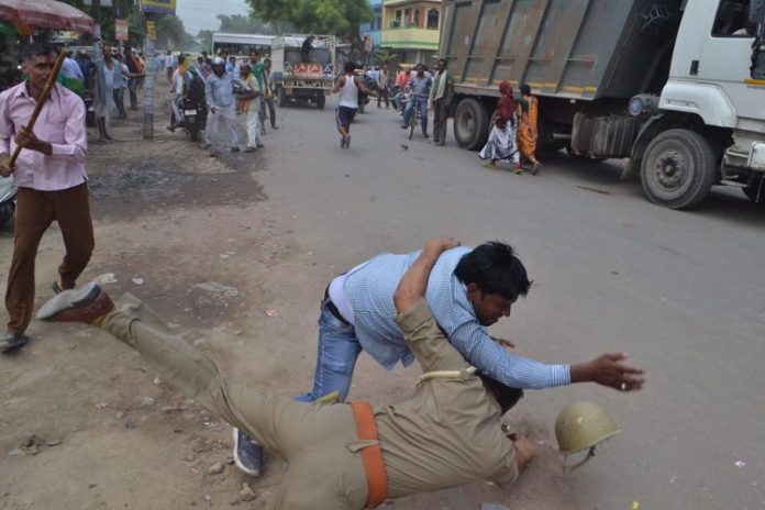 policemen thrashed