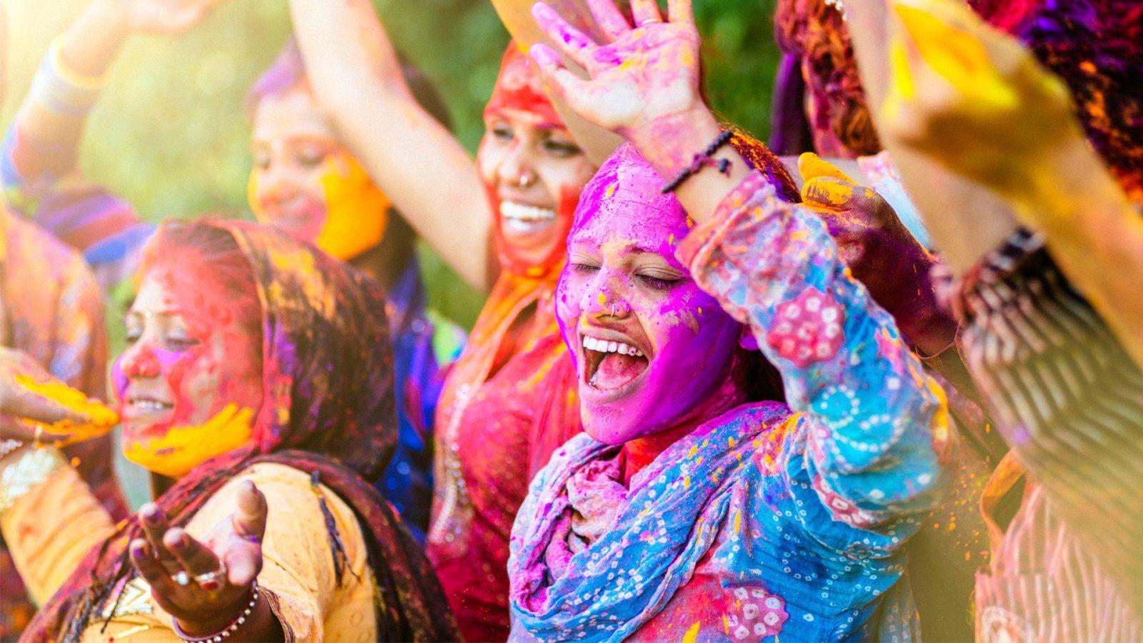 Indian women playing holi