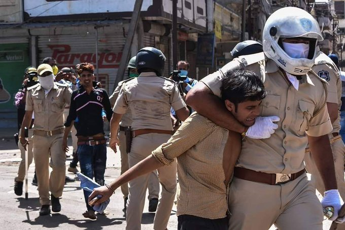 Stranded Migrant Workers being detained by Police in Surat, Gujarat