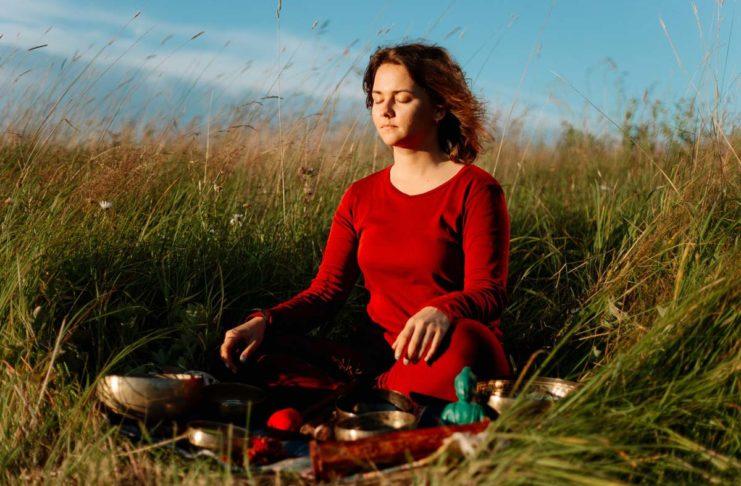 Woman Sitting in a field